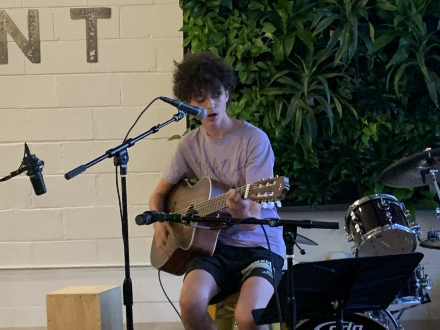 """Sophomore Owen Widuch plays his original song, Dysphoria, at the Amateur Musicians Club gig at Brewpoint Craft. """"I put a lot of feelings from the last few years into this song and it feels great to play it for people."""""""