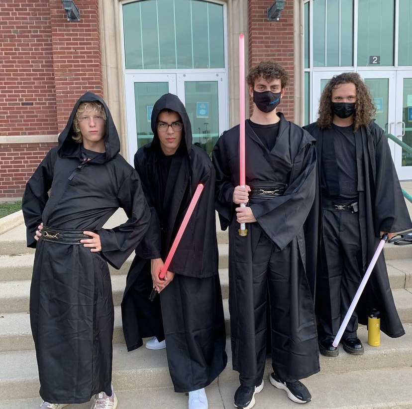 Seniors Michael Spurr, Andrew Brooks, Daniel Sanders and Trent Cefolia pose on the front staircase, clutching their signature light sabers.   The Darth Dukes expressed determination to have as much fun as possible and meet new people.  Photo courtesy of @darthdukes instagram