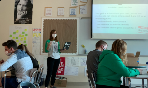 English teacher Mrs. Riley teaches her senior elective Chicago Literature course  and applies the technology skills she honed during remote learning to teach in person.