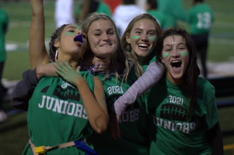 Juniors celebrate their win against the seniors at this years annual Girls Flag Football game. (AJ Swiatek)