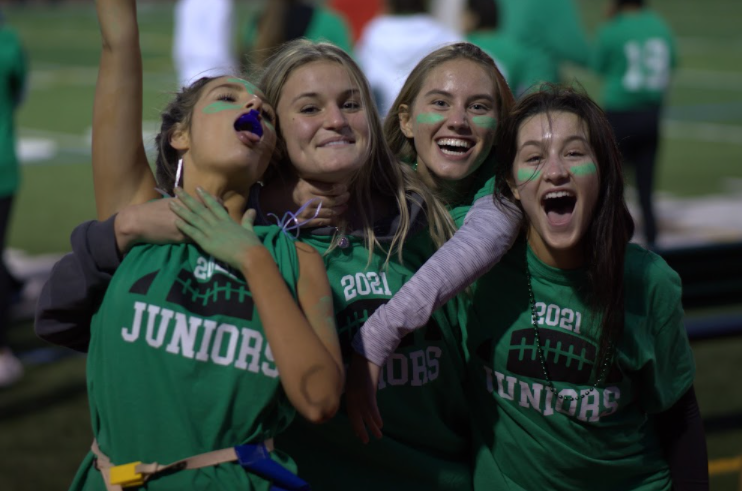 Juniors celebrate their win against the seniors at this years annual Girls Flag Football game. Photo By Nate Stettin