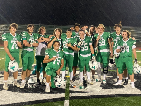 Members of the varsity football team pose after defeating Lyons Township. Obviously it was a huge accomplishment for the program, and something that hasnt been done in 10 years, coach Michael Fitzgerald said. Im just really proud of the kids for all the hard work they put in to get us back to a winning program.