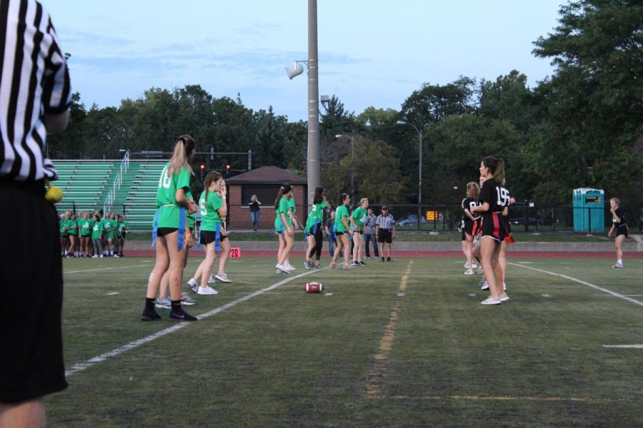 Juniors and seniors get prepared for to play in the 2019 flag football game.